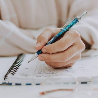 ReAwaken woman writing